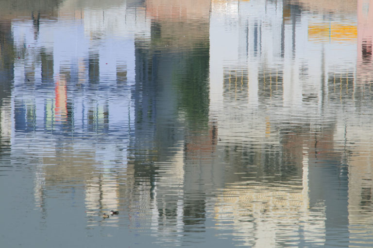 The buildings of Pushkar are mirrored in the lake.