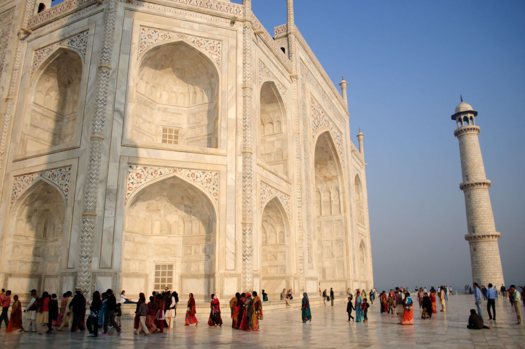 Crowds stroll outside of the taj mahal
