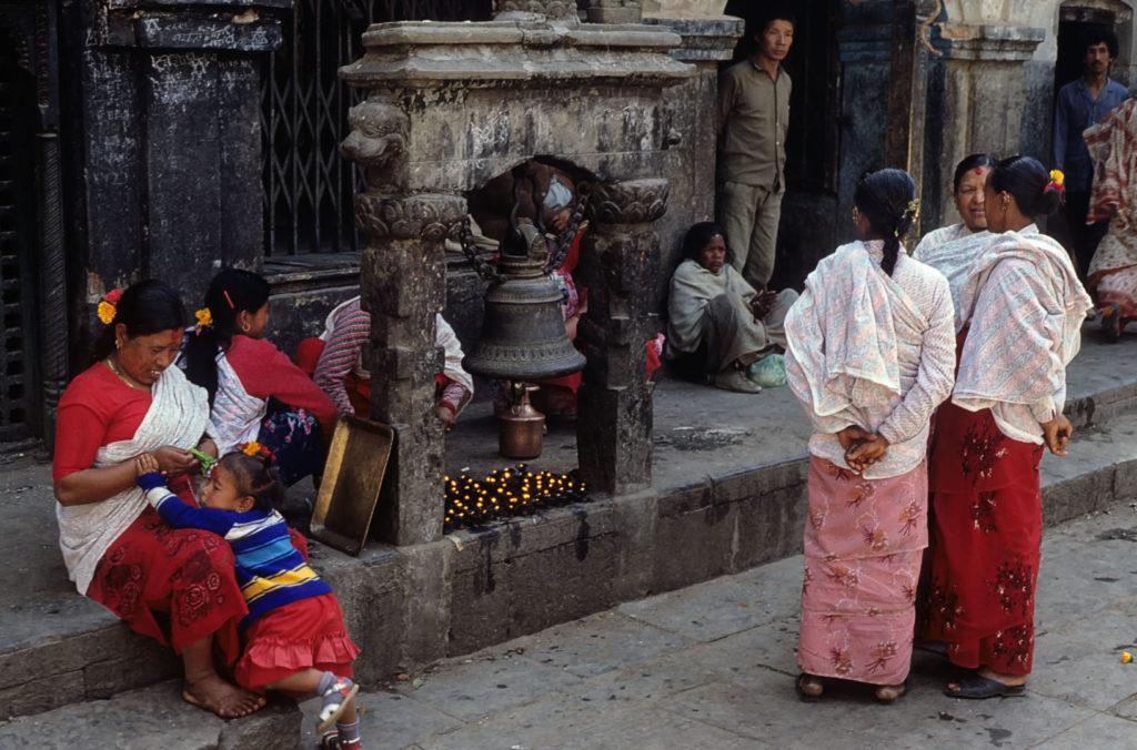 Women visit a temple in Kathmandu.