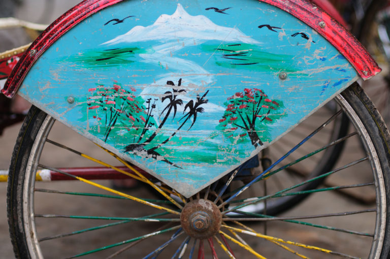 rickshaw with painted mountain decoration in Kathmandu.