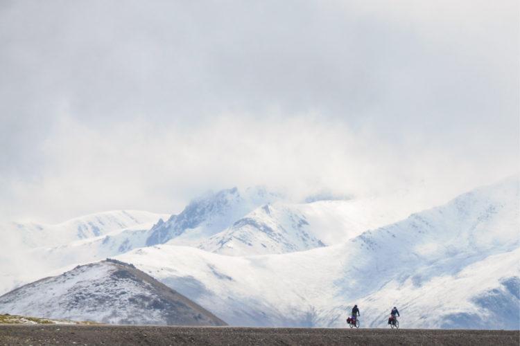 Stephane Girard cycling through the mountains in Kyrgyzstan