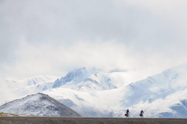 Stephane Girard cycling through the mountains in Kyrgyzstan