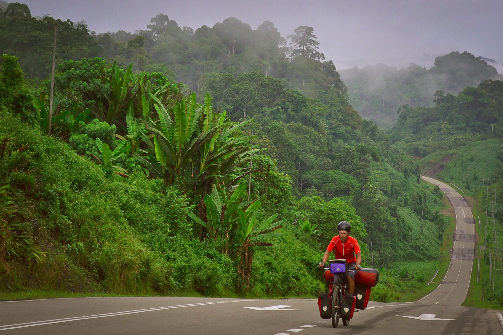 Amaya Williams and Eric Schambion cycling in Borneo