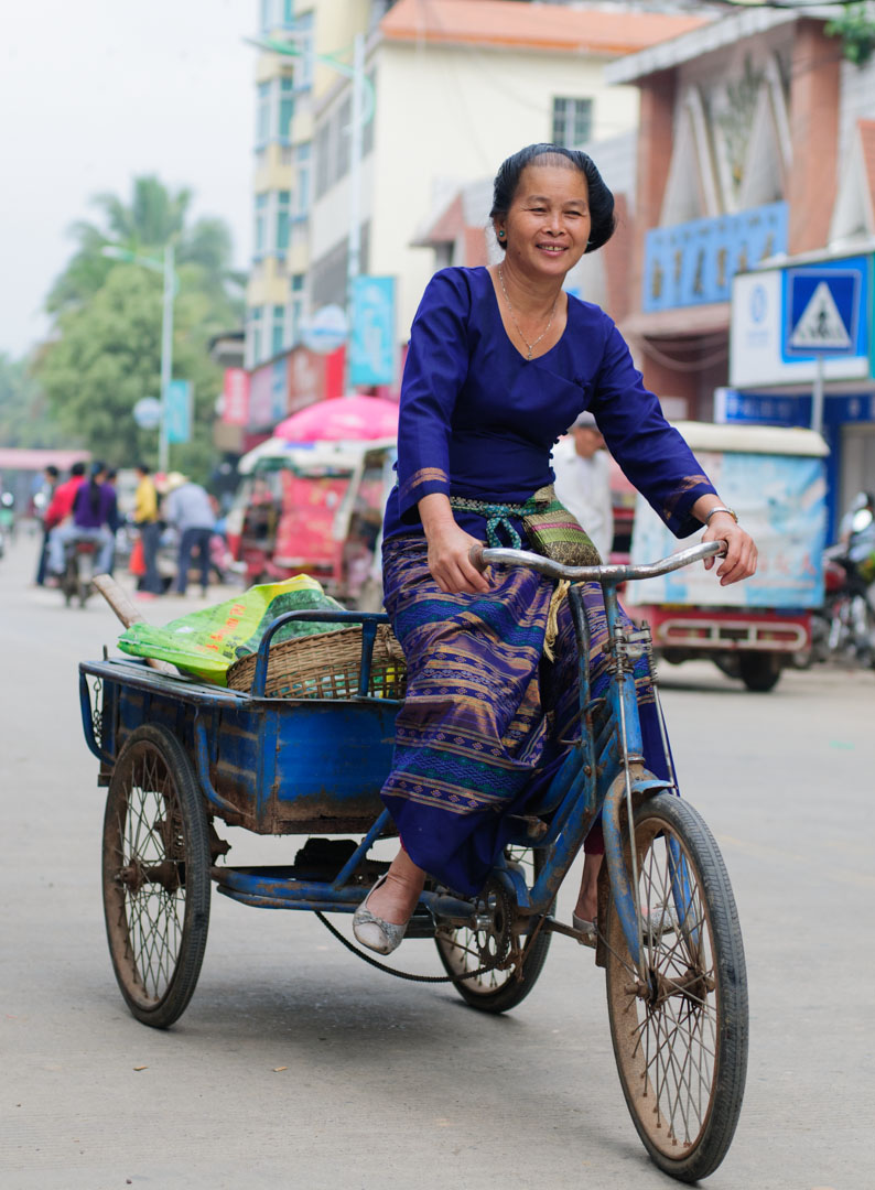 Chinese woman cycles to the market