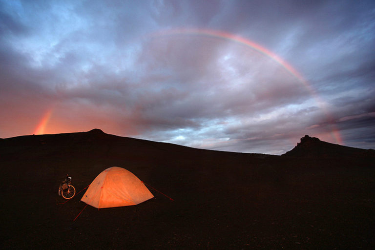 John Freeman camping on a bike trip through Iceland