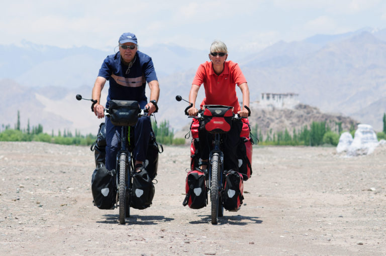 Paul and Grace cycling in the Himalayas.