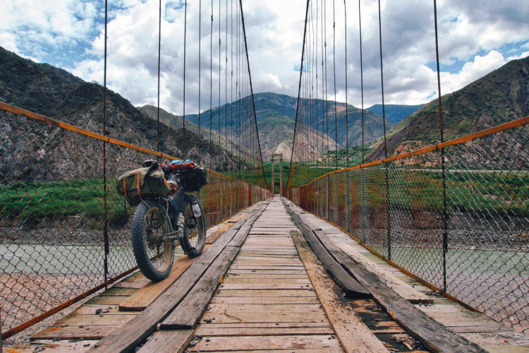 Mike Howarth's bike leans against a bridge in Peru.