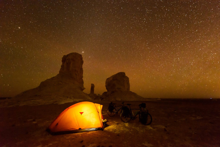 Nicolas Marino camping in the Egyptian desert.