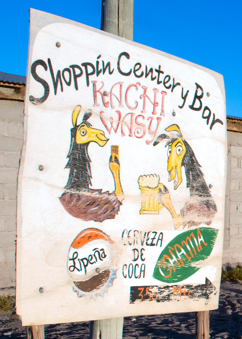 Lamas are painted on a bar sign in Bolivia.