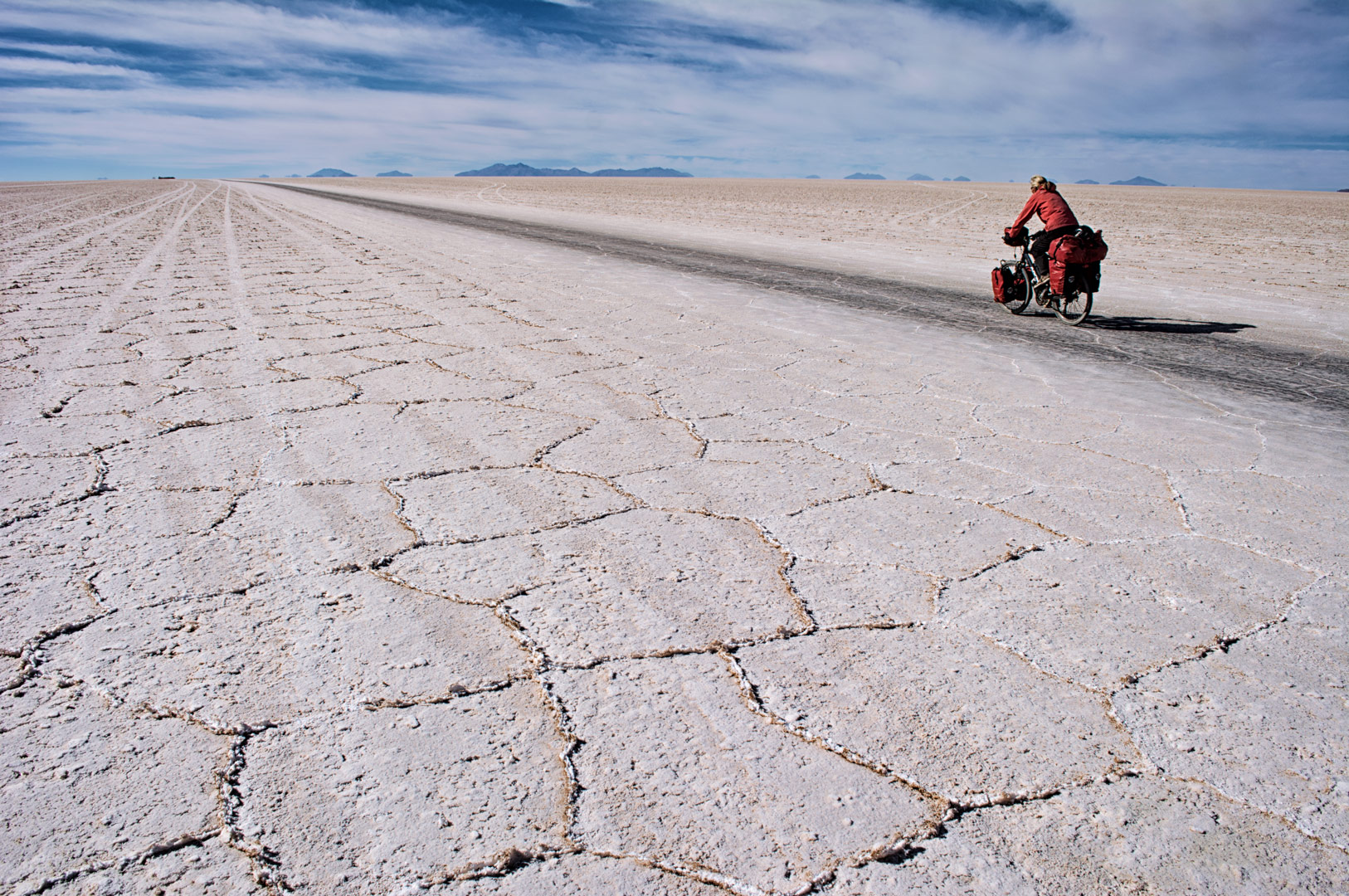Cycling across the immense Salar de Uyuni.