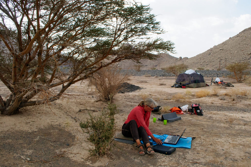 Starting up the computer while wild camping in Oman.