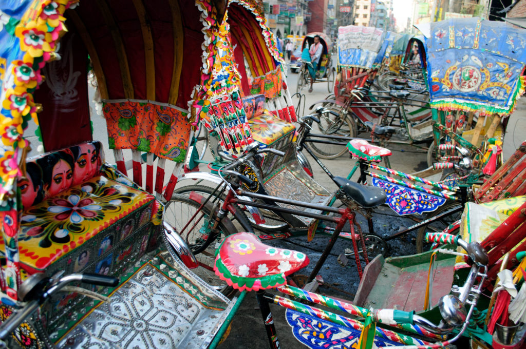 Brightly colored rickshaws in Dhaka, Bangladesh.