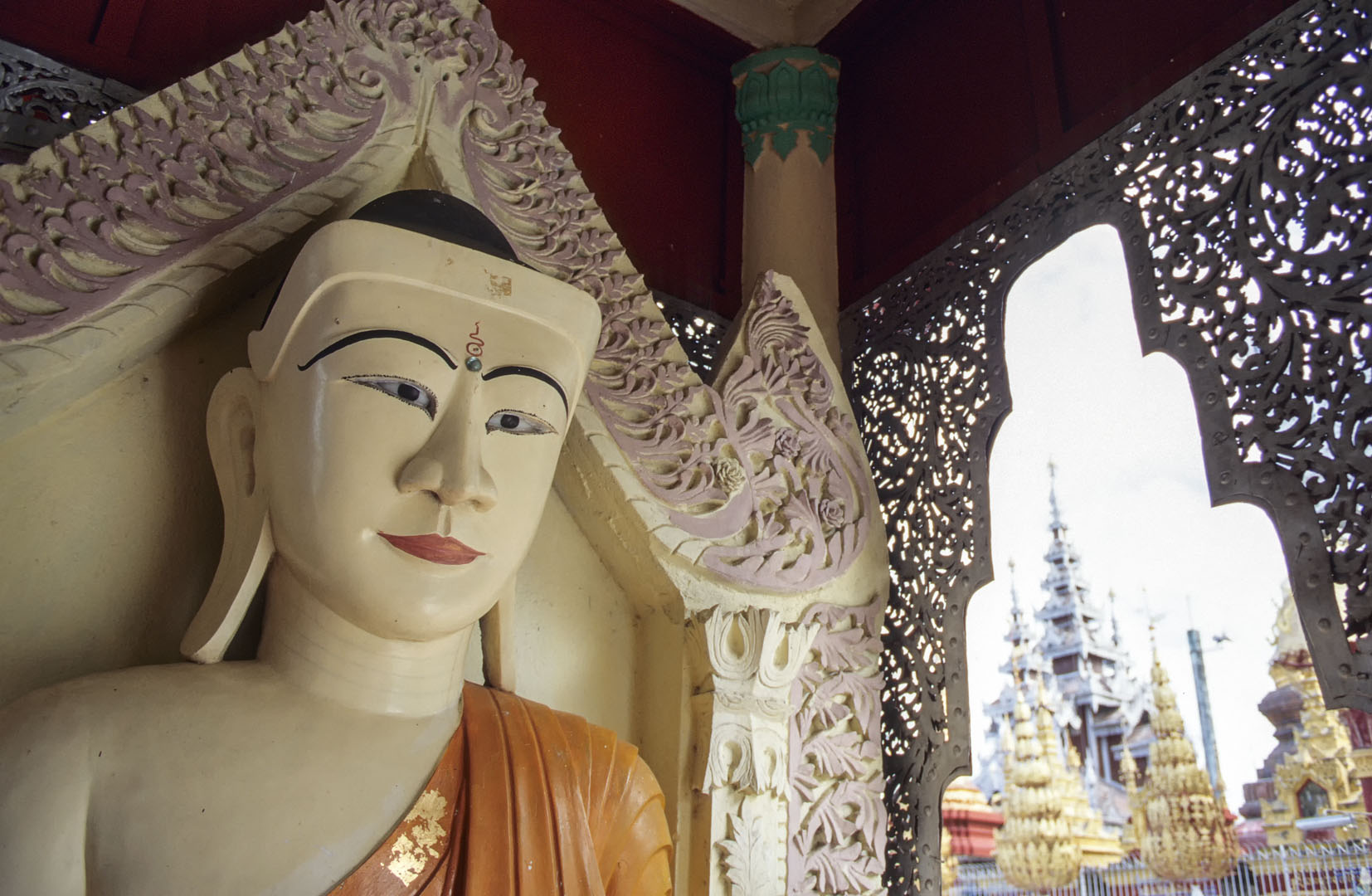 A white Buddha statue in Myanmar.