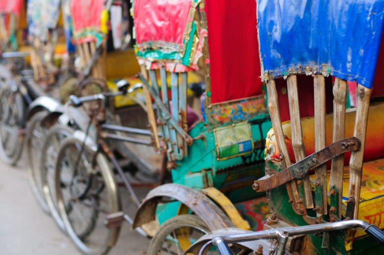 Colorful parked rickshaws in Dhaka.